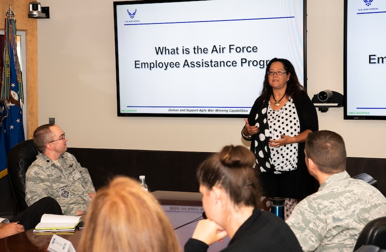 Danna Plewe, Air Force Employee Assistance Program Manager, briefs personnel on the benefits of the EAP, at Schriever Air Force Base, Colorado, Aug. 7, 2019. The EAP is a professional service which provides problem solving, coaching, information, consultation, counseling, resource identification and support to all civilian and non-appropriated fund employees. (U.S. Air Force photo by Staff Sgt. Matthew Coleman-Foster)
