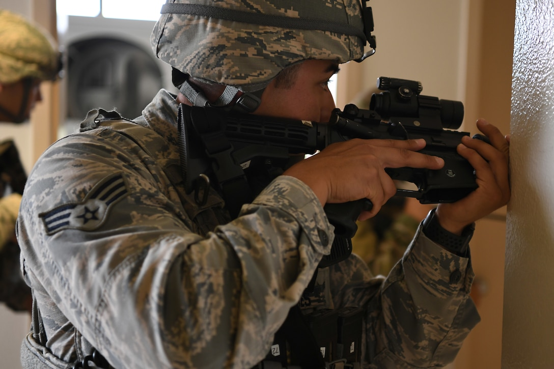 Senior Airman Pedro Cazares, 30th Security Forces Squadron patrolman, sweeps a building during an active shooter exercise Aug. 7, 2019, at Vandenberg Air Force Base, Calif.