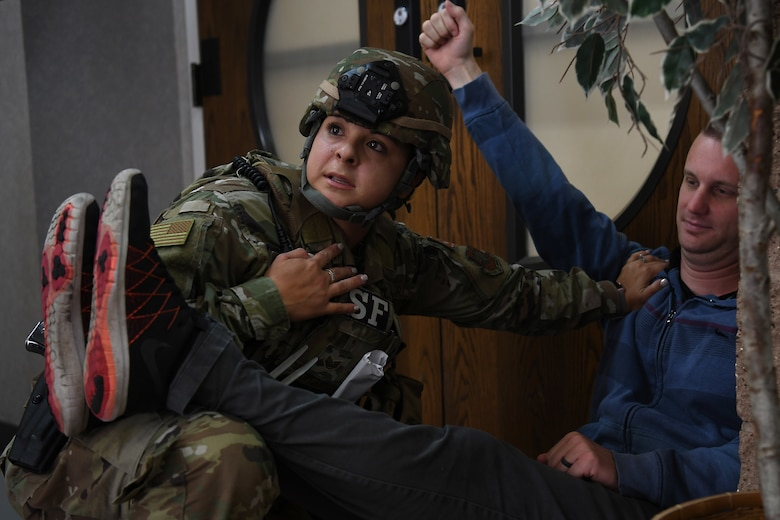 Staff Sgt. Cinthia Swartzlander, 30th Security Forces Squadron patrolman, provides emergency aid to a simulated victim during an active shooter exercise Aug. 7, 2019, at Vandenberg Air Force Base, Calif.