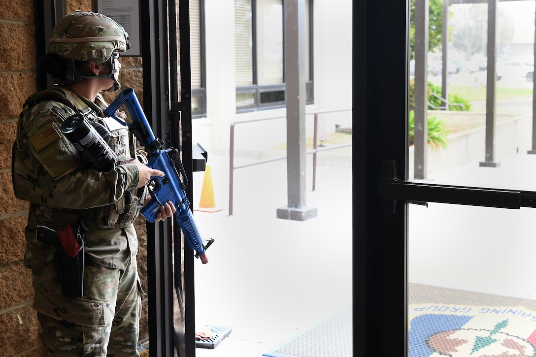 Staff Sgt. Cinthia Swartzlander, 30th Security Forces Squadron patrolman, guards an exit during an active shooter exercise Aug. 7, 2019, at Vandenberg Air Force Base, Calif.