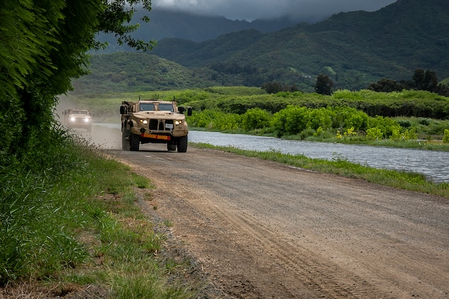 U.S. Marines with 3d Marine Regiment drive a Joint Light Tactical Vehicle (JLTV) during a JLTV field training exercise, Marine Corps Training Area Bellows, July 29, 2019. The JLTV Family of Vehicles is a U.S. Army-led, joint acquisition program with the U.S. Marine Corps, is intended to close an existing, critical capability gap in the services' light tactical wheeled vehicle fleets. The Marine Corps' Joint Light Tactical Vehicles has achieved initial operational capability. (U.S. Marine Corps photo by Cpl. Matthew Kirk)