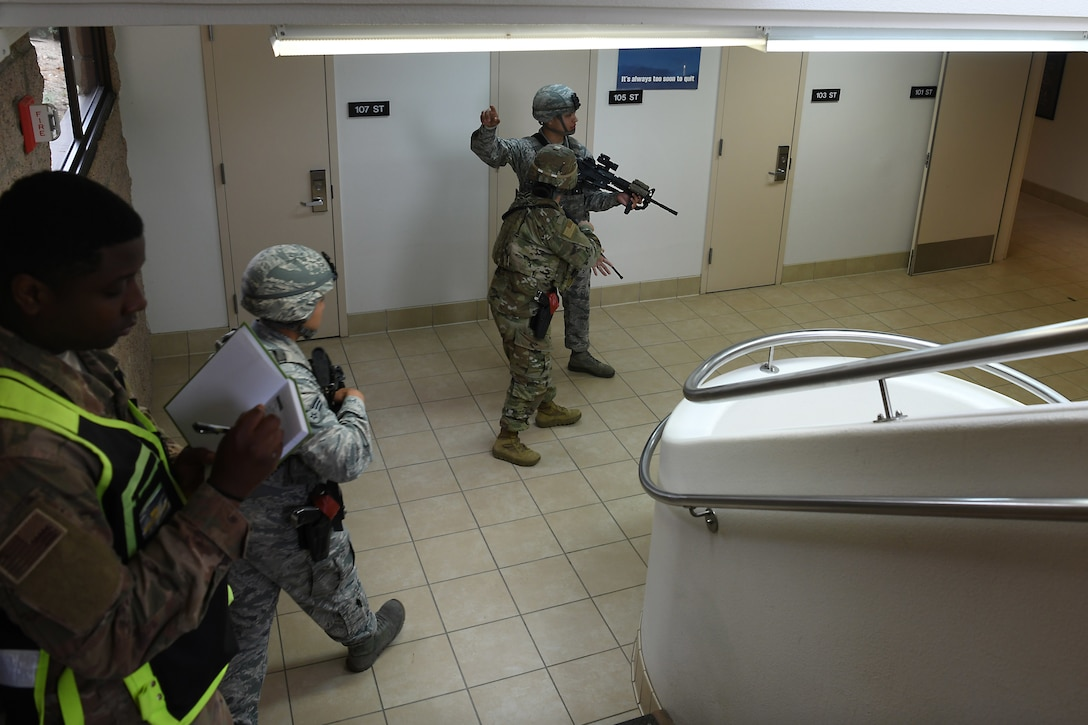 Airmen assigned to the 30th Security Forces Squadron sweep a building during an active shooter exercise Aug. 7, 2019, at Vandenberg Air Force Base, Calif.