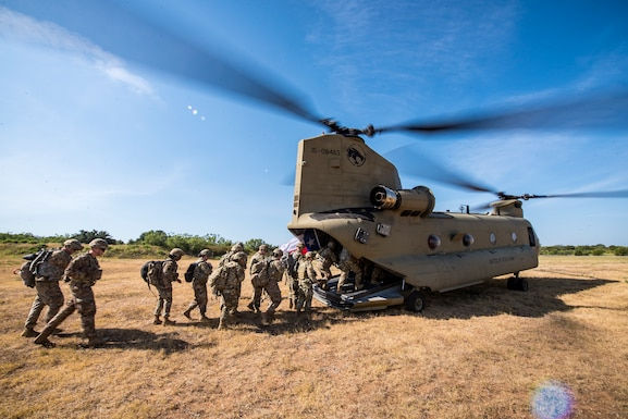 Airmen from the 3d Weather Squadron (WS) enter a CH47-Chinook following a certification field exercise (CFX). Air Force Combat Weather, Air Combat Command, ACC, Air Force