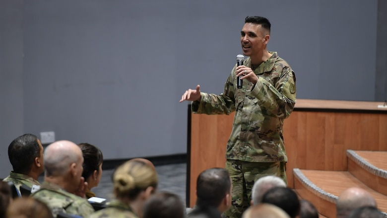 Chief Master Sgt. Shawn L. Drinkard, U.S. Air Forces Central Command command chief, addresses base personnel about the importance of the non-commissioned officer core values and resiliency during a visit to Ali Al Salem Air Base, Kuwait, Aug. 8, 2019. AFCENT leadership visited the 386th Air Expeditionary Wing to discuss how each Airman's role contributes to the mission, to take questions and address concerns. (U.S. Air Force photo by Staff Sgt. Mozer O. Da Cunha)