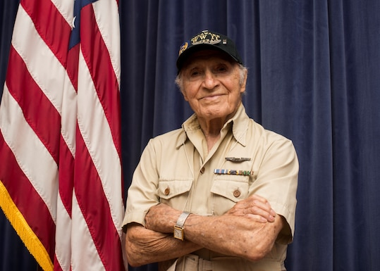 U.S. Army Air Corps 1st Lt. (ret) Raymond Firmani, World War II B-17 pilot, visits the 166th Airlift Wing to conduct at Hangar Talk at New Castle Air National Guard Base Del., Aug. 10, 2019. During the event, Firmani shared stories from his time as a pilot, flying 25 combat missions during World War II. (U.S. Air National Guard Photo by Staff Sgt. Katherine Miller)