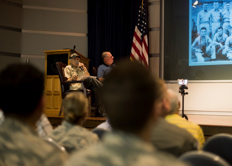 U.S. Army Air Corps 1st Lt. (ret) Raymond Firmani, World War II B-17 pilot, left and Mr. Mitchell Topal, 166th Airlift Wing public affairs specialist, right, speak to the crowd during a Hangar Talk at New Castle Air National Guard Base Del., Aug. 10, 2019. Firmani served as a B-17 pilot and flew 25 combat missions during World War II in 1944 and 1945. (U.S. Air National Guard Photo by Staff Sgt. Katherine Miller)