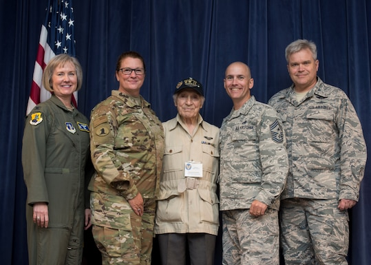 U.S. Army Air Corps 1st Lt. (ret) Raymond Firmani, World War II B-17 pilot, meets with Delaware Air National Guard leadership at the conclusion of a Hangar Talk at New Castle Air National Guard Base Del., Aug. 10, 2019. The Hangar Talk event allowed Airmen to learn history in the profession of Arms as well as become more aware of the changing operations of the military. (U.S. Air National Guard Photo by Staff Sgt. Katherine Miller)