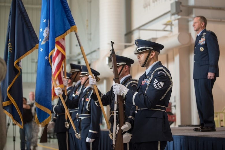 "Members of the 123rd Airlift Wing Honor Guard present the colors during a ceremony recognizing Lt. Col. John ""J.T."" Hourigan at the Kentucky Air National Guard Base in Louisville, Ky., Aug. 10, 2019. Hourigan, a C-130 pilot, was awarded the Distinguished Flying Cross for preventing a catastrophic, in-flight mishap that would have resulted in the loss of aircraft and crew if not for his decisive action. (U.S. Air National Guard photo by Staff Sgt. Joshua Horton)"