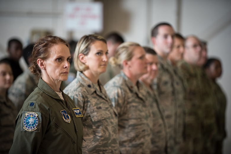 "Members of the 123rd Airlift Wing attend a ceremony at the Kentucky Air National Guard Base in Louisville, Ky., Aug 10, 2019, during which the Air Force chief of staff, Gen. David L. Goldfein, presented the Distinguished Flying Cross to a Kentucky Air Guard pilot. The pilot, Lt. Col. John ""J.T."" Hourigan, earned the medal for decisive action following a catastrophic mechanical failure while flying a C-130 Hercules aircraft during a routine training sortie, saving the lives of six crew members and a $30 million aircraft. Flight Surgeon Lt. Col. Donna Stewart (far left) was one of those crew members. (U.S. Air National Guard photo by Lt. Col. Dale Greer)"
