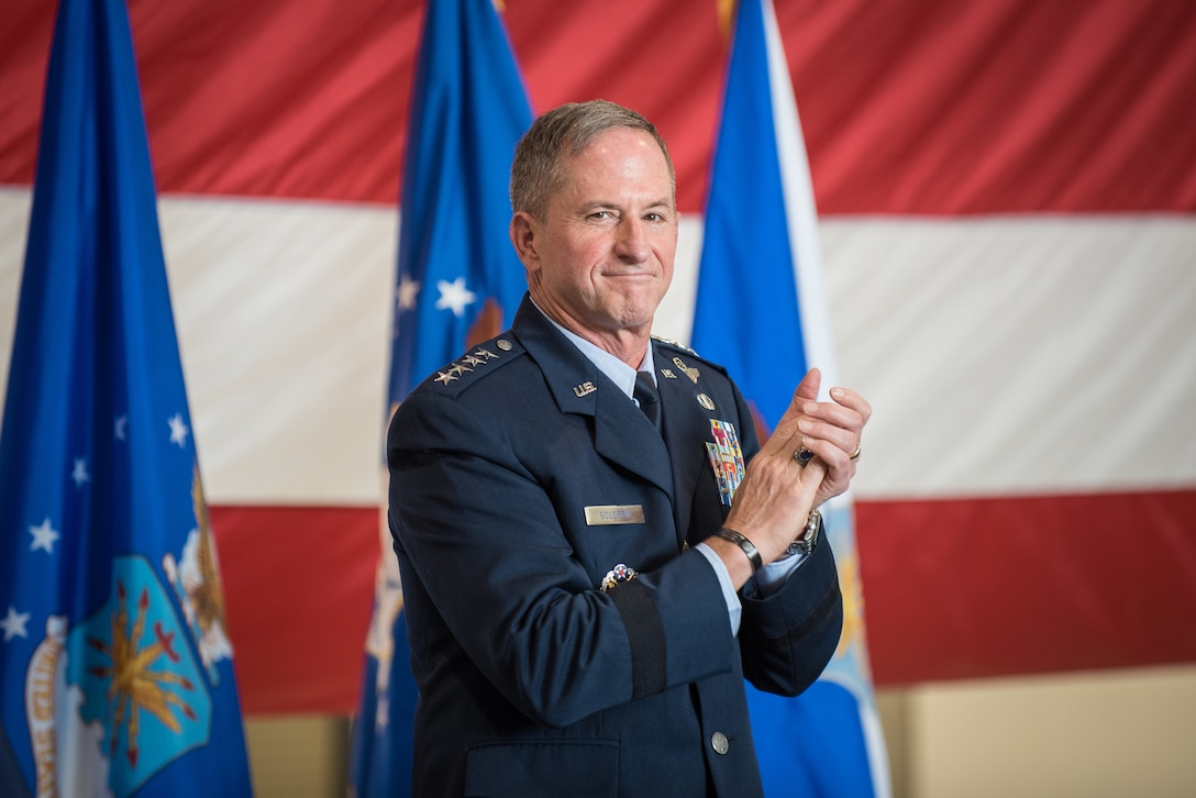 """Air Force Chief of Staff Gen. David L. Goldfein applauds Lt. Col. John """"J.T."""" Hourigan during a ceremony to award the Distinguished Flying Cross to Hourigan at the Kentucky Air National Guard Base in Louisville, Ky., Aug. 10, 2019. The 123rd Airlift Wing pilot earned the medal for decisive action following a catastrophic mechanical failure while flying a C-130 Hercules during a routine training sortie, saving the lives of six crew members and a $30 million aircraft. (U.S. Air National Guard photo by Lt. Col. Dale Greer)"""