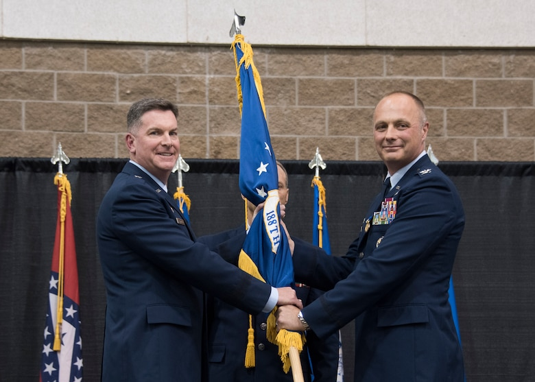 Col. Robert I. Kenney relinquishes command of the 188th Wing to Brig. Gen. Thomas D. Crimmins, Arkansas National Guard air component commander, during a change of command ceremony at Fort Smith, Ark., Aug. 11, 2019. The change of command is a military tradition signified with the passing of the unit's guidon flag from one commander to the next. (U.S. Air National Guard photo by Tech. Sgt. John E. Hillier)