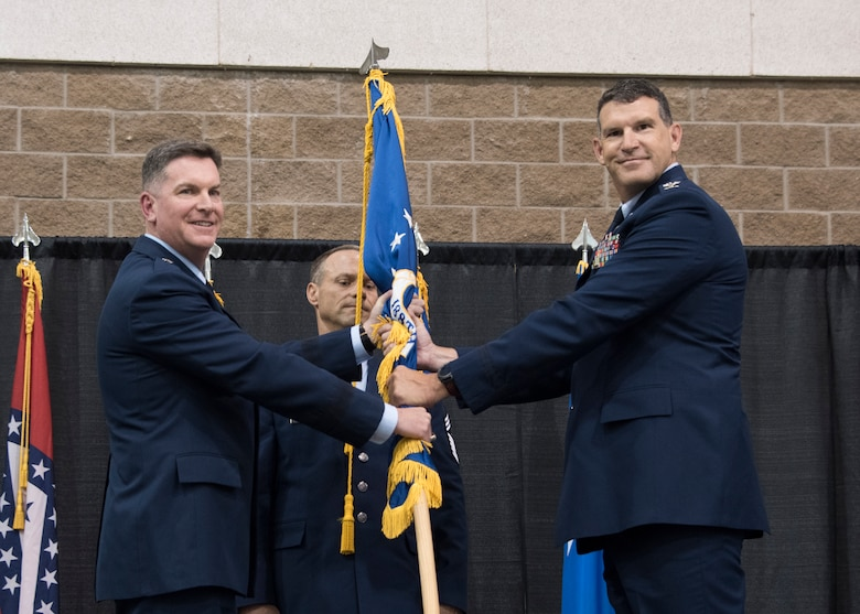 Col. Leon J. Dodroe assumes command of the 188th Wing from Brig. Gen. Thomas D. Crimmins, Arkansas National Guard air component commander, during a change of command ceremony at Fort Smith, Ark., Aug. 11, 2019. The change of command is a military tradition signified with the passing of the unit's guidon flag from one commander to the next. (U.S. Air National Guard photo by Tech. Sgt. John E. Hillier)