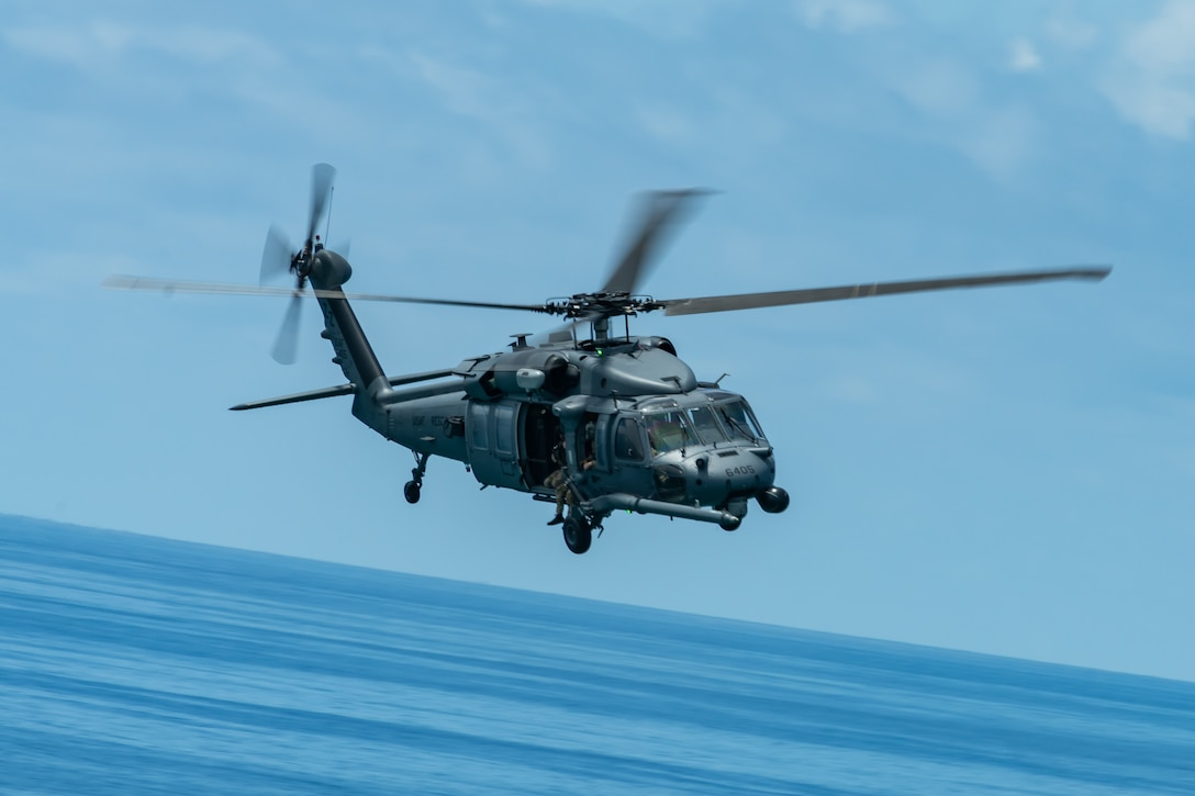 An HH-60G Pave Hawk from the 33rd Rescue Squadron flies during a training exercise, July 23, 2019, out of Kadena Air Base, Japan. The 33rd RQS has performed search, rescue, and recovery missions since 1952. (U.S. Air Force photo by Airman 1st Class Matthew Seefeldt)