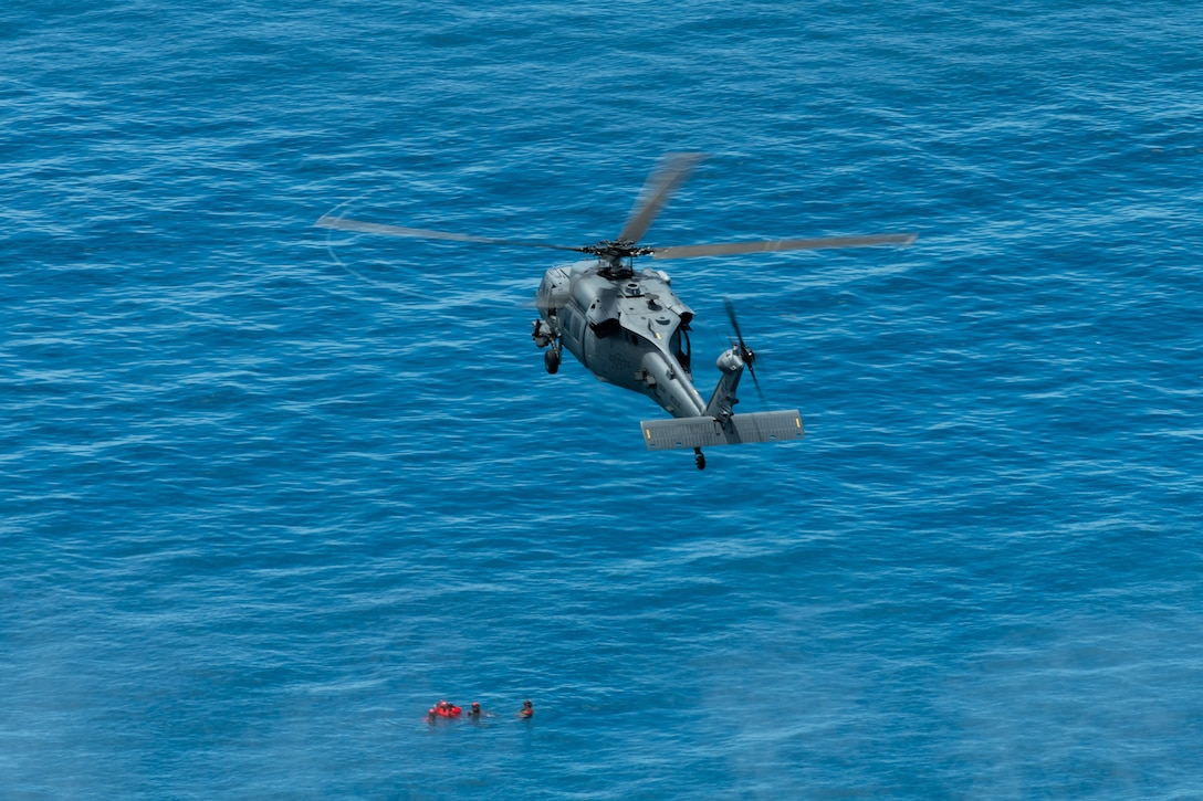 An HH-60G Pave Hawk from the 33rd Rescue Squadron flies during a training exercise, July 23, 2019, out of Kadena Air Base, Japan. Members of the 33rd and 31st Rescue Squadrons from Kadena AB train and work together to provide support for combat rescue and disaster relief. (U.S. Air Force photo by Airman 1st Class Matthew Seefeldt)