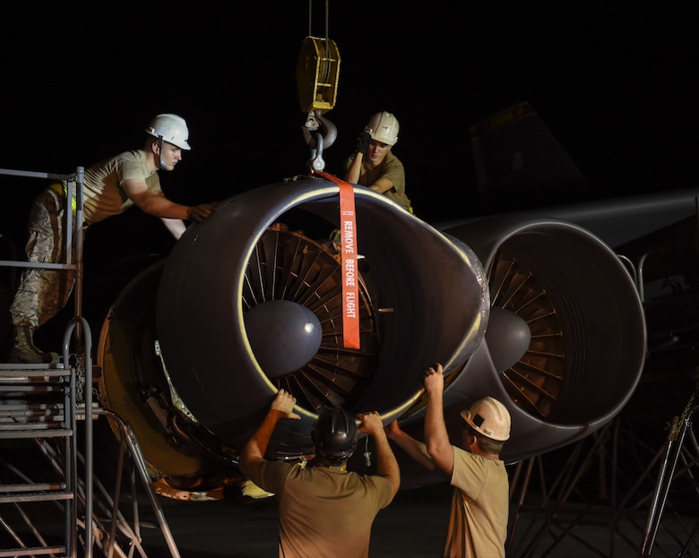 36th Expeditionary Aircraft Maintenance Squadron Airmen install a ring cowl on a 69th Expeditionary Bomb Squadron B-52 Stratofortress  on Andersen Air Force Base, Guam, Aug. 7, 2019.