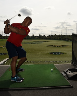 U.S. Air Force Capt. CJ Rode, 48th Medical Support Squadron Research Management flight commander, participates in a spiritual resiliency event in Chigwell, England, Aug. 3, 2019. Participants at the event practiced focus and concentration through the game of Topgolf. (U.S. Air Force photo by Airman 1st Class Rhonda Smith)