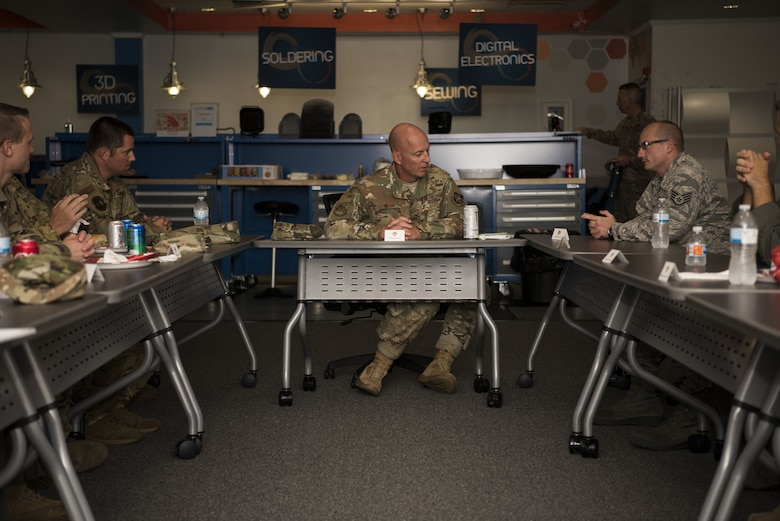 U.S. Air Force Chief Master Sgt. Chris Simpson, 18th Air Force command chief receives input from NCOs during a tour on Joint Base McGuire-Dix-Lakehurst, N.J., Aug. 2, 2019. Simpson sat down with Airmen to discuss how their units are operating and the mental state of their co-workers. (U.S. Air Force photo by Airman 1st Class Ariel Owings)