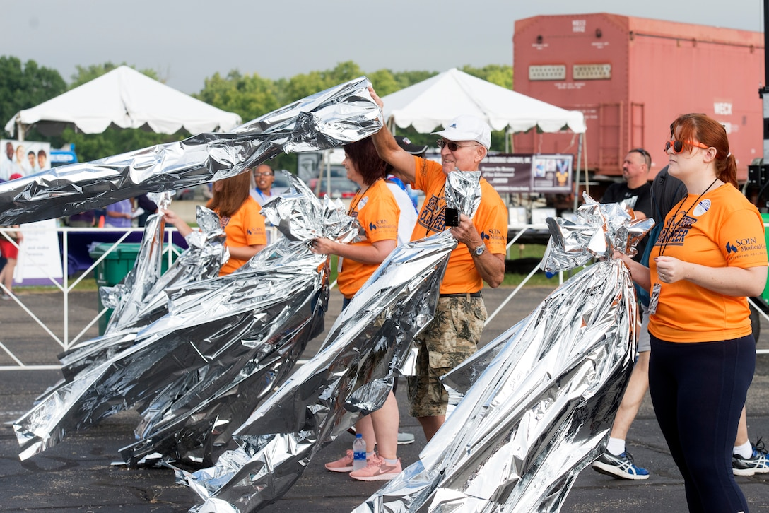 The Air Force Marathon has signed on to the United Nations Framework Convention on Climate change to continue their efforts to make a difference in the environment and community by minimizing waste and improve conservation. One of the several initiatives that will be taken at this year's marathon is heat sheets that are handed out to runners at the finish line will now be made out of recycled material and after use, they are collected and recycled into other products. (U.S. Air Force photo/Michelle Gigante)
