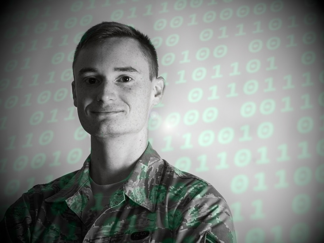 U.S. Air Force Senior Airman Dorian Stacy, 423rd Communications Squadron network operations technician, poses for a photo at RAF Alconbury, England, August 8, 2019. Stacy is in charge of securing network operations and ensuring proper access and permissions are in place at RAF Alconbury and RAF Molesworth. (U.S. Air Force illustration by Master Sgt. Brian Kimball)