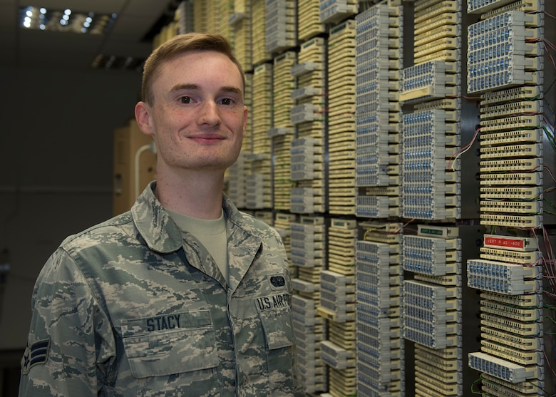 U.S. Air Force Senior Airman Dorian Stacy, 423rd Communications Squadron network operations technician, poses for a photo in a network server room at RAF Alconbury, England, August 8, 2019. Stacy is in charge of securing network operations and ensuring proper access and permissions are in place at RAF Alconbury and RAF Molesworth. (U.S. Air Force photo by Airman 1st Class Jennifer Zima)