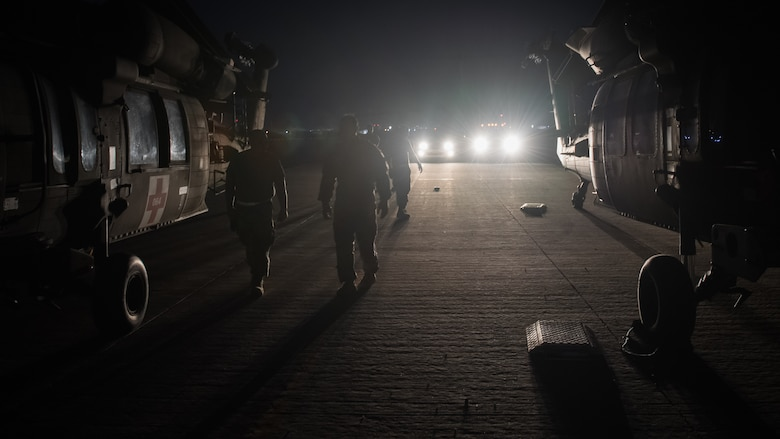 U.S. Airmen and Soldiers prepare to perform a joint inspection on two U.S. Army UH-60 Black Hawk helicopters at Ali al Salem Air Base, Kuwait, Aug. 9, 2019. Service members assigned to the 386th Expeditionary Logistics Readiness Squadron and the 8-229th Assault Helicopter Battalion inspect the Black Hawks to ensure they're airworthy to load onto U.S. Air Force C-17 Globemaster III aircraft. The Black Hawks will then undergo transport to a location within the U.S. Central Command area of responsibility. Inspectors perform a number of functions including measuring and weighing the helicopter, thoroughly assessing the aircraft and unloading its cargo to ensure it meets the safety requirements for transport. (U.S. Air Force photo by Tech. Sgt. Daniel Martinez)