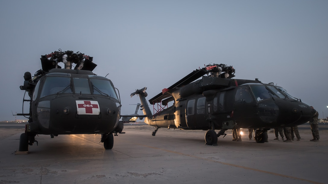 U.S. Airmen and Soldiers perform a joint inspection on two U.S. Army UH-60 Black Hawk helicopters at Ali al Salem Air Base, Kuwait, Aug. 9, 2019. Service members assigned to the 386th Expeditionary Logistics Readiness Squadron and the 8-229th Assault Helicopter Battalion inspect the Black Hawks to ensure they're airworthy to load onto U.S. Air Force owned C-17 Globemaster III aircraft. The Black Hawks will then undergo transport to a location within the U.S. Central Command area of responsibility. (U.S. Air Force photo by Tech. Sgt. Daniel Martinez)