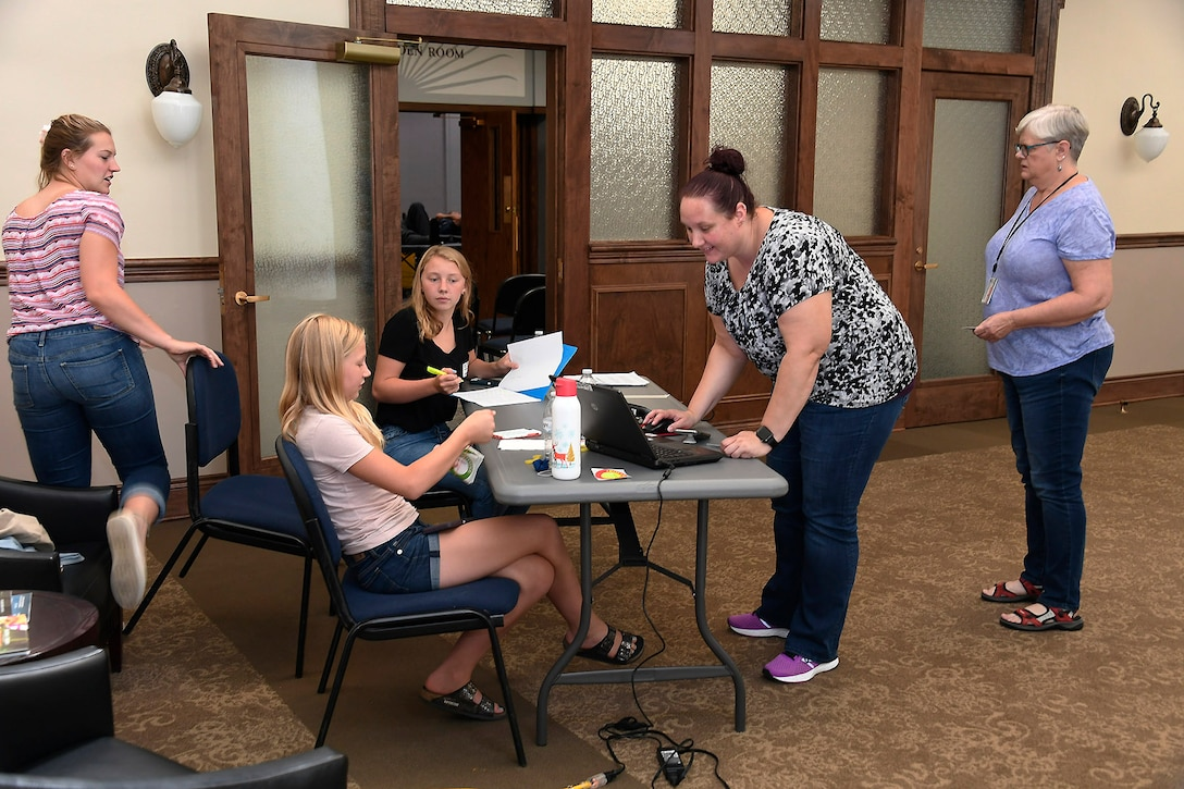 Volunteers check-in donors for their appointments at the Aug. 7 blood drive at the Hart-Dole-Inouye Federal Center.