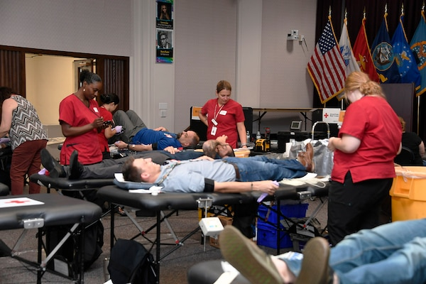 Red Cross workers assist donors at the Aug. 7 blood drive at the Hart-Dole-Inouye Federal Center.