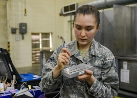 Senior Airman Aliyah Vasquez, 412th MXS, Non-Destructive Inspection Section, demonstrates a scanning tool used to identify cracks in air plane parts. (U.S. Air Force photo by Giancarlo Casem)