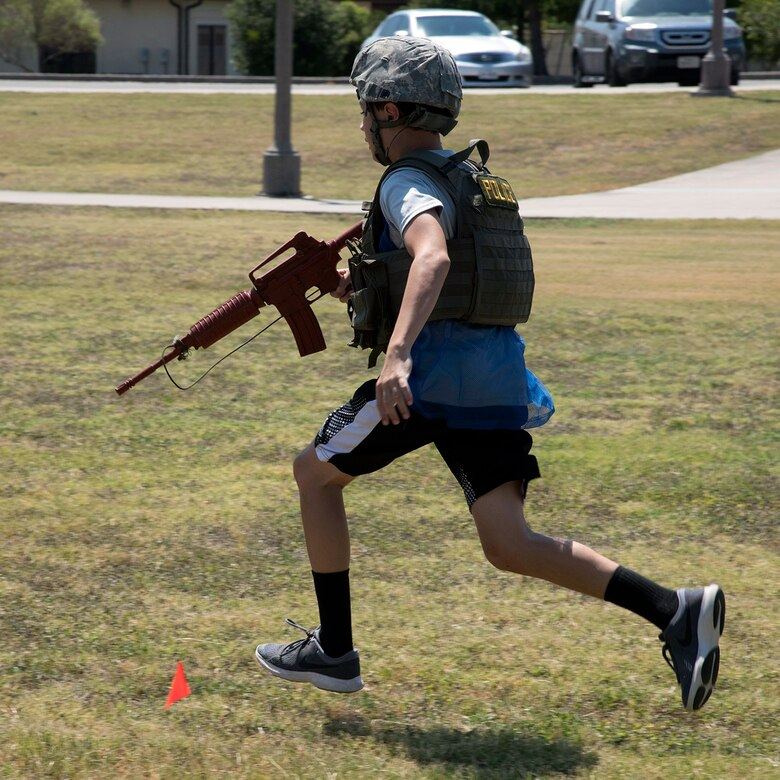 A participant runs during the Junior Battle of the Badges staged by the 902nd Security Forces Squadron at Heritage Park on Joint Base San Antonio-Randolph Aug. 2. (U.S. Air Force photo by Brian Lepley)