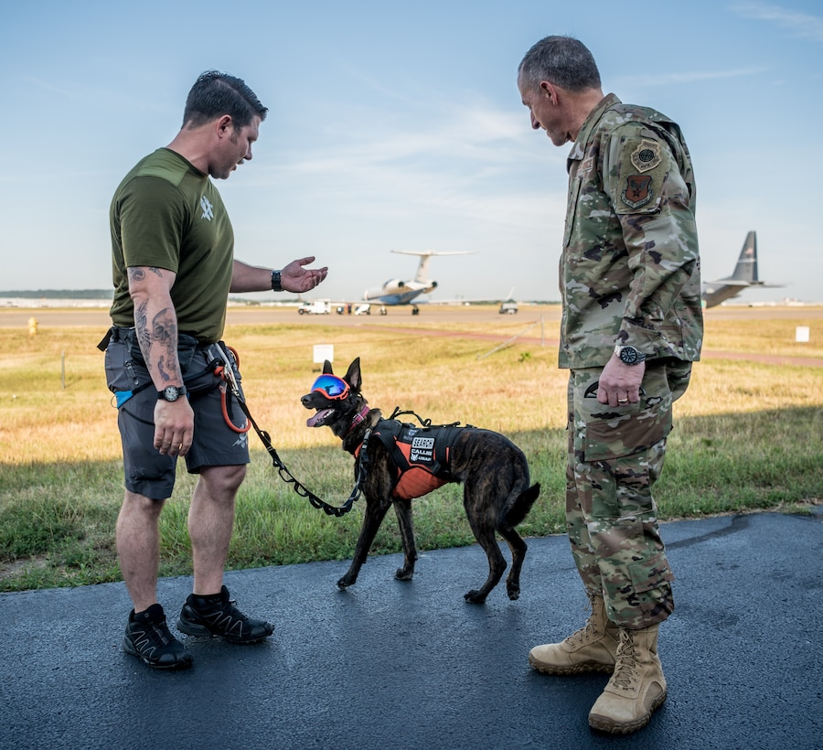 Air Force Chief of Staff Gen. David L. Goldfein (right), meets Callie, the only search-and-rescue dog in the Department of Defense, and her handler, Master Sgt. Rudy Parsons, a pararescueman in the 123rd Special Tactics Squadron, during a tour of the Kentucky Air National Guard Base in Louisville, Ky., Aug. 10, 2019. Goldfein toured various work centers, learning about the unique mission sets of the 123rd Airlift Wing. (U.S. Air National Guard photo by Staff Sgt. Joshua Horton)