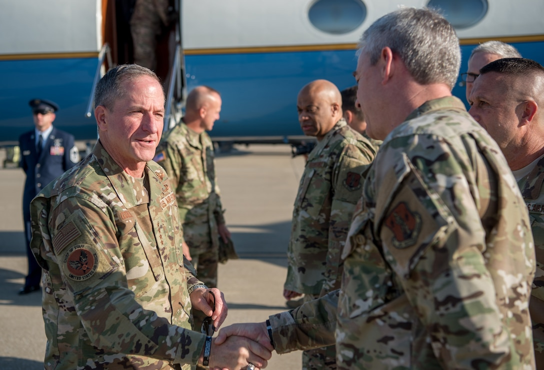 Air Force Chief of Staff Gen. David L. Goldfein (left) greets Chief Master Sgt. Shane Lagrone, 123rd Airlift Wing command chief, upon arrival at the Kentucky Air National Guard Base in Louisville, Ky., Aug. 10, 2019. Goldfein toured various work centers, learning about the unique mission sets of the 123rd Airlift Wing. (U.S. Air National Guard photo by Staff Sgt. Joshua Horton)