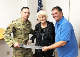 Command Chief Master Sgt. Ian EISHEN, 412th Test Wing Command Chief Master Sergeant, presented Edwards Air Force Base Civilian-Military Support Group President Al Hoffman and Civ-Mil Founder, Aida O'Connor with a commemorative sword in recognition of Civ-Mil's 30 years of continuous support to Edwards AFB. (U.S. Air Force photo by Danny Bazzell)