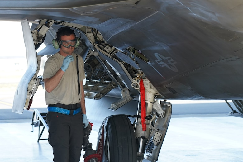 Air Force Staff Sgt. Jacob Boddy, a crew chief assigned to the 525th Fighter Squadron, holds a refueling hose after Airmen assigned to the 673d Logistics Readiness Squadron refueled an F-22 Raptor on Joint Base Elmendorf-Richardson, Alaska, Aug. 9, 2019.  Fuels specialists manage every aspect of the refueling every aircraft on the flight line and are responsible for operating the vehicles, equipment and storage facilities that are essential to refueling operations while ensuring compliance with all safety regulations while handling these volatile liquids.