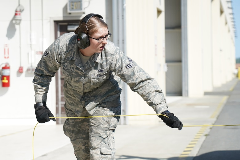 Senior Airman Jessica Wilt, a native of Washington Court House, Ohio, assigned to the 673d Logistics Readiness Squadron, uncoils a grounding cable before refueling an F-22 Raptor of the 525th Fighter Squadron (the Bulldogs) on Joint Base Elmendorf-Richardson, Alaska, Aug. 9, 2019.  Fuels specialists manage every aspect of the refueling every aircraft on the flight line and are responsible for operating the vehicles, equipment and storage facilities that are essential to refueling operations while ensuring compliance with all safety regulations while handling these volatile liquids.