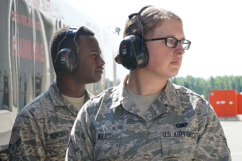 Senior Airman Jessica Wilt, right, and Airman 1st Class Anthony Moncrief, both assigned to the 673d Logistics Readiness Squadron, refuel an F-22 Raptor of the 525th Fighter Squadron (the Bulldogs) on Joint Base Elmendorf-Richardson, Alaska, Aug. 9, 2019.  Fuels specialists manage every aspect of the refueling every aircraft on the flight line and are responsible for operating the vehicles, equipment and storage facilities that are essential to refueling operations while ensuring compliance with all safety regulations while handling these volatile liquids.