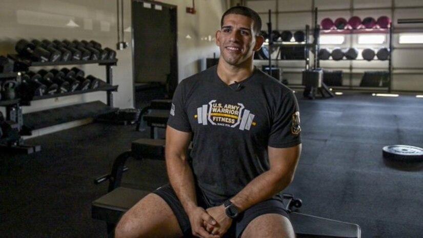 Soldier sitting in gym.