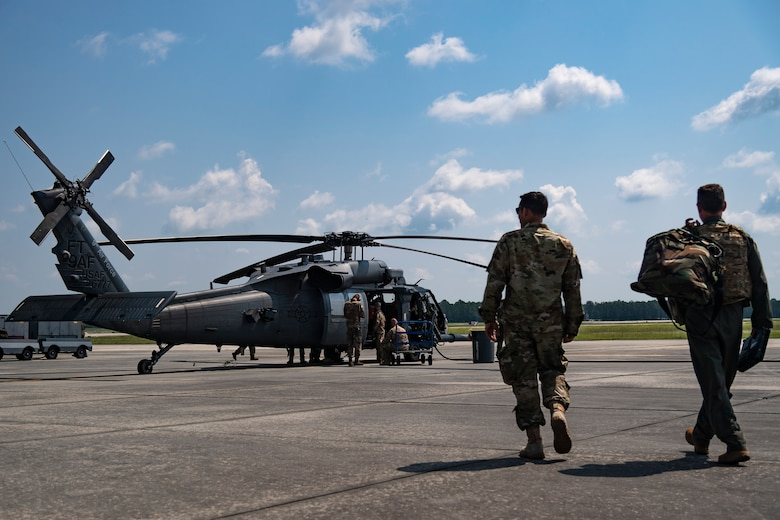 U.S. Air Force Maj. Gen. Chad Franks, right, Ninth Air Force commander, and Maj. Eric Cranford, 723d Aircraft Maintenance Squadron maintenance operations office, walks the flightline to an HH-60G Pave Hawk at Moody Air Force Base, Ga., Aug. 8, 2019. It was Franks' initial flight in the Ninth Air Force commander's flagship aircraft, an HH-60G Pave Hawk assigned to the 41st Rescue Squadron. Franks, who on separate occasions served as the commander for the 23d Wing and 347th Rescue Group, is a command pilot with more than 3,300 hours in multiple aircraft including HC-130J Combat King II and HH-60G Pave Hawk. (U.S. Air Force photo by Airman 1st Class Taryn Butler)