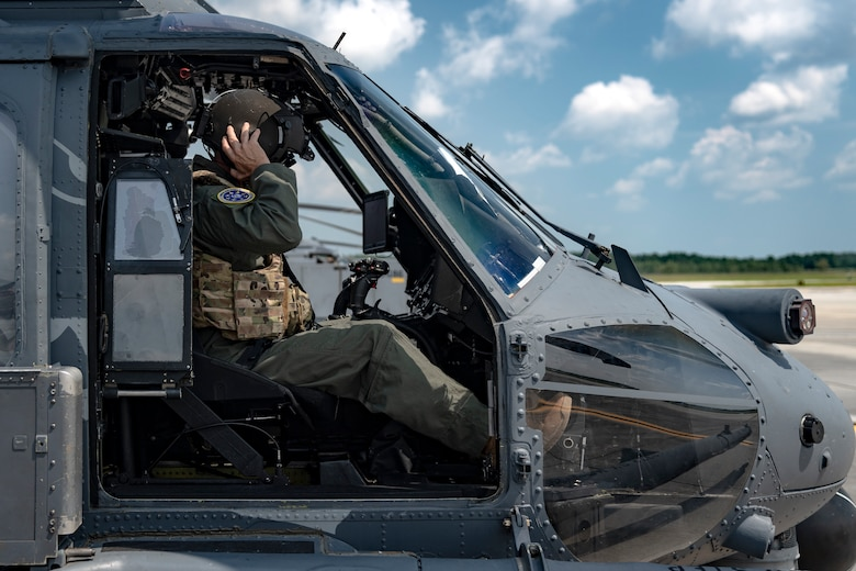 U.S. Air Force Maj. Gen. Chad Franks, Ninth Air Force commander, dons a helmet in an HH-60G Pave Hawk before a flight at Moody Air Force Base, Ga., Aug. 8, 2019. It was Franks' initial flight in the Ninth Air Force commander's flagship aircraft, an HH-60G Pave Hawk assigned to the 41st Rescue Squadron. Franks, who on separate occasions served as the commander for the 23d Wing and 347th Rescue Group, is a command pilot with more than 3,300 hours in multiple aircraft including HC-130J Combat King II and HH-60G Pave Hawk. (U.S. Air Force photo by Airman 1st Class Taryn Butler)