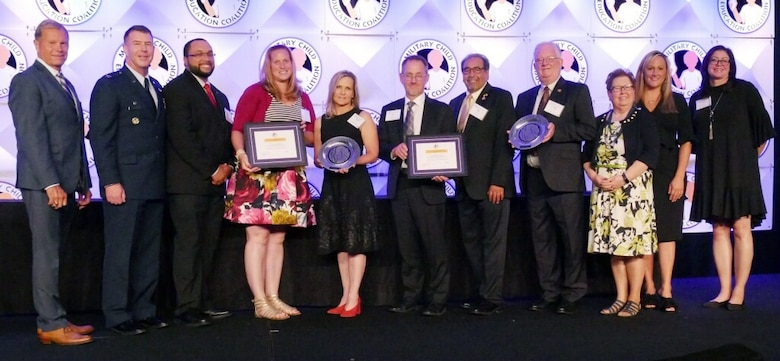 Members of Cannon Air Force Base and the Clovis community receive the Pete Taylor Partnership of Excellence Award in Washington, D.C., July 23, 2019. A package was submitted to the Military Child Education Collection to nominate Cannon and Clovis for the K-12 category. It outlined the programs in place to promote the growth of Cannon's military children and the relationships between Cannon and Clovis schools. (Courtesy Photo)