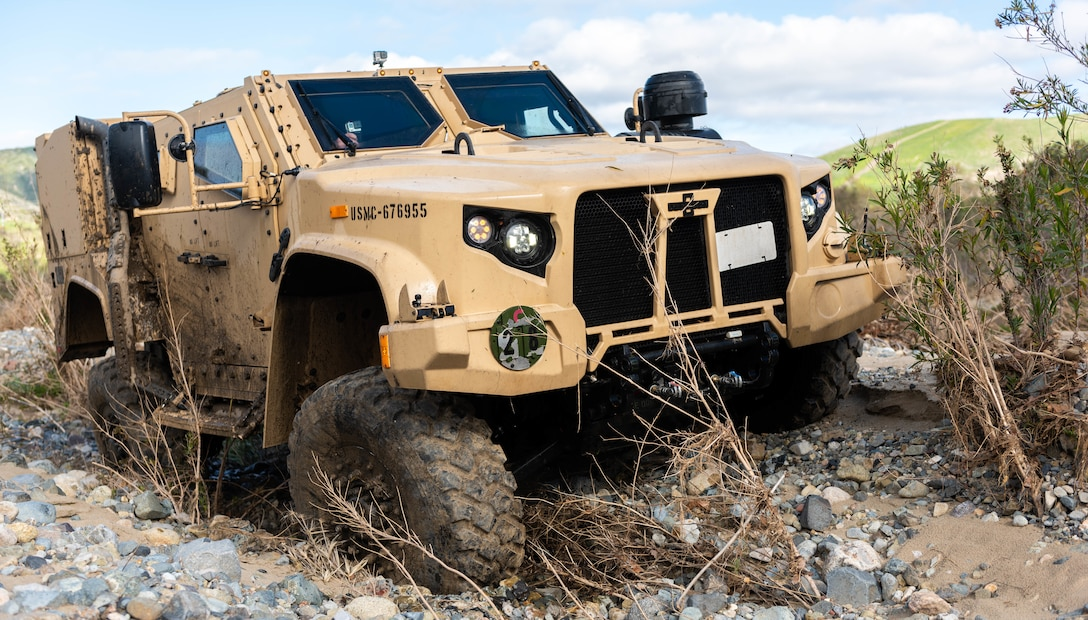 A Joint Light Tactical Vehicle displays its ability to handle multiple terrain types by physically adjusting its suspension during a demonstration at the School of Infantry West, Marine Corps Base Camp Pendleton, California, Feb. 27, 2019. Marines are able to adjust multiple drive settings of the JLTV by selecting options on an internal LCD. These settings affect how the vehicle drives in sandy, muddy, snowy or highway road conditions. The JLTV consists of multiple platforms capable of completing a variety of missions while providing increased protection and mobility for personnel across the Marine Corps.