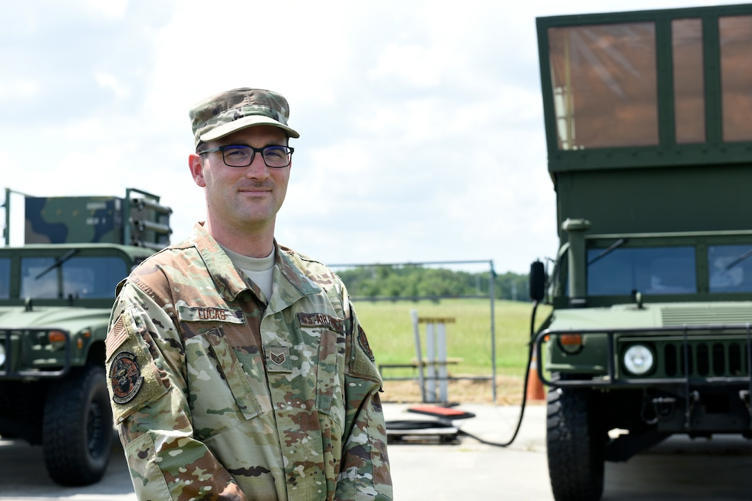 U.S. Air Force Staff Sgt. William Lucas, radar airfield weather systems technician with the 235th Air Traffic Controller Squadron, poses in front of a mobile air traffic control tower set in New London, N.C. that was recently used in a training mission in Ramstein Germany, Aug. 3rd, 2019. The North Carolina Air National Guard, along with New Hampshire and Maine Air National Guard, flew to Ramstein Air Base, Germany to work with active duty 1st Combat Communications Squadron. The Air National Guard units assisted in training the active duty unit with set-up, use, and tear-down of a mobile tower and deployable tactical air navigation system.