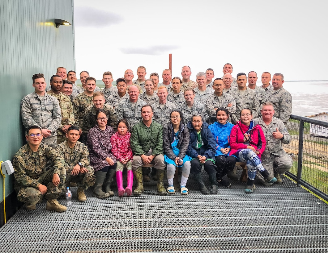 Villagers from Newtok, Alaska, pose with Air Force reservists in the 419th Civil Engineer Squadron from Hill Air Force Base, Utah, on Aug. 8.