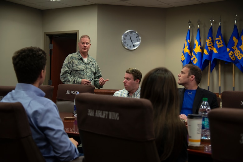 Col. James DeVere, the 302nd Airlift Wing commander speaks to congressional staff members about the wing's mission sets and Air Force Reserve at Peterson Air Force Base, Colorado, Aug. 7, 2019.