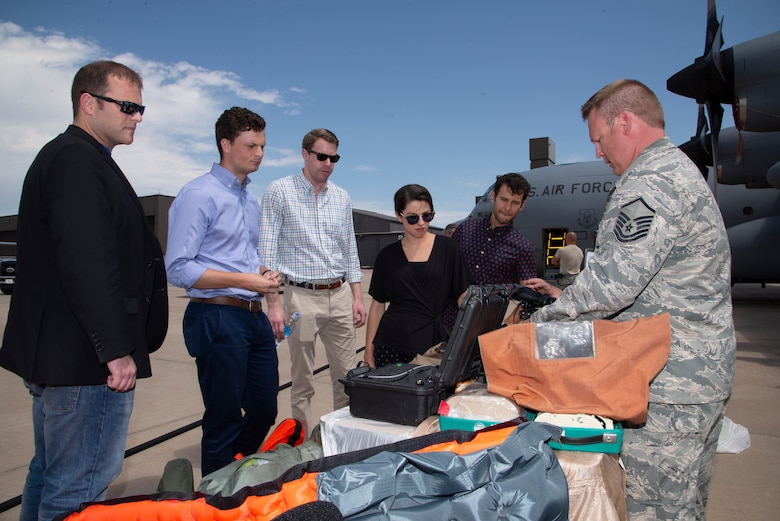 Master Sgt. Brent Renholm, a 302nd Aircrew Flight Equipment flight chief, explains how 302nd Airlift Wing aircrew use the equipment maintained by his shop to congressional staffers during their visit at Peterson Air Force Base, Colorado, Aug. 7, 2019.