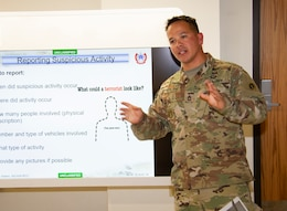 Sgt. 1st Class Elias Solano, antiterrorism / force protection noncommissioned officer, 1st Theater Sustainment Command (TSC), instructs students on how to detect suspicious behaviors during an antiterrorism awareness course, Aug. 7, 2019, at Fort Knox, Ky.