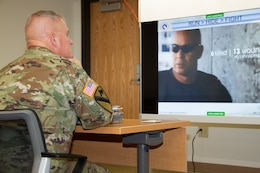 A 1st Theater Sustainment Command (TSC) member listens intently as he receives instruction on what to do during an active shooter incident Aug. 7, 2019, at Fort Knox, Ky.