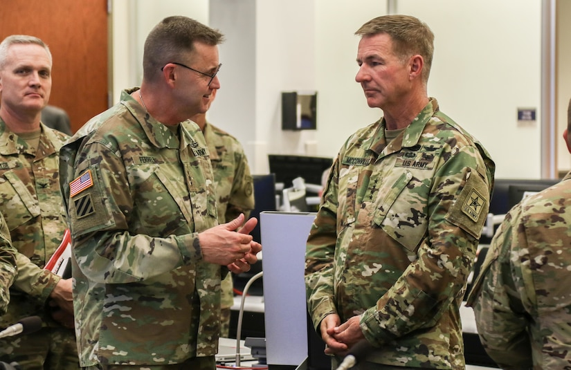 Gen. James McConville (right), U.S. Army Chief of Staff, tours the U.S. Army Central Operations Center with Lt. Gen. Terry Ferrell (left), USARCENT commanding general, at the command's headquarters on Shaw Air Force Base, S.C., Aug. 1, 2019.
