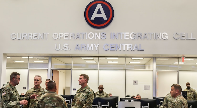 Gen. James McConville (center), U.S. Army Chief of Staff, tours the U.S. Army Central Operations Center with Lt. Gen. Terry Ferrell, USARCENT commanding general, at the command's headquarters on Shaw Air Force Base, S.C., Aug. 1, 2019.