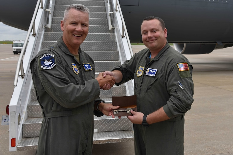 Master Sgt. Jeremy Pratt, 344th Air Refueling Squadron chief boom operator presents the keys of the aircraft to Maj. Gen. James Jacobson, Headquarters Air Force director of training and deputy chief of staff for operations, plans and requirements, August 9, 2019, McConnell Air Force Base, Kan. The installation continues to assist the integration of the next generation air mobility platform. (U.S. Air Force photo by Airman 1st Class Marc A. Garcia)